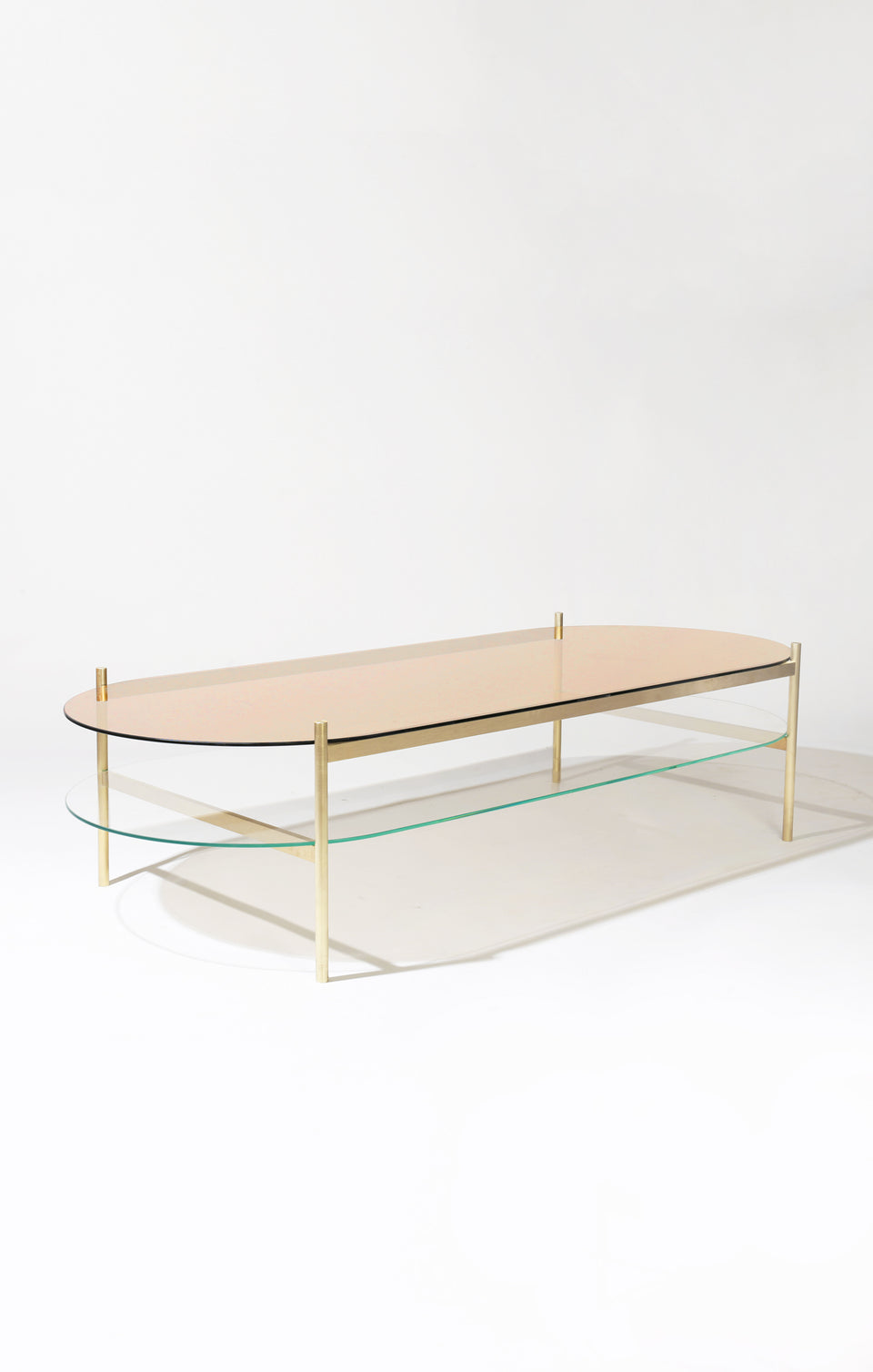 Duotone Pill Coffee Table - Brass Frame / Rose Glass / Clear Glass