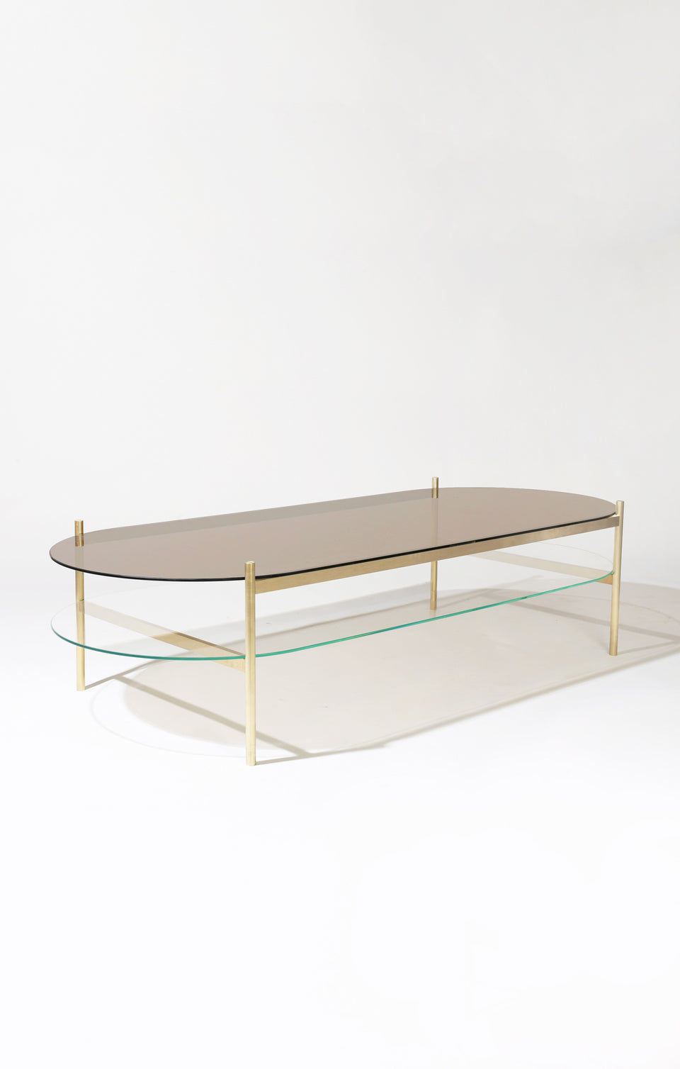 Duotone Pill Coffee Table - Brass Frame / Bronze Glass / Clear Glass