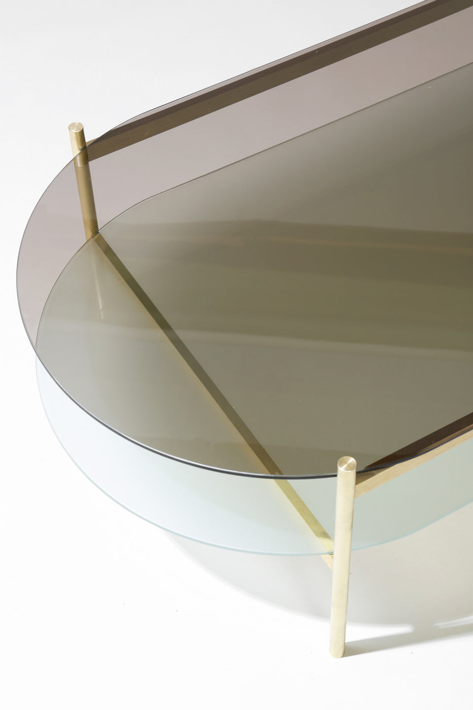 Duotone Pill Coffee Table   Brass Frame / Bronze Glass / Frosted Glass