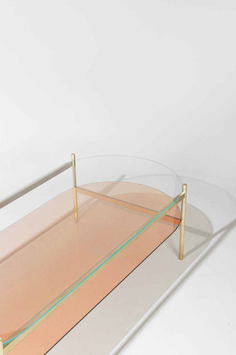 Duotone Pill Coffee Table - Brass Frame / Clear Glass / Rose Glass