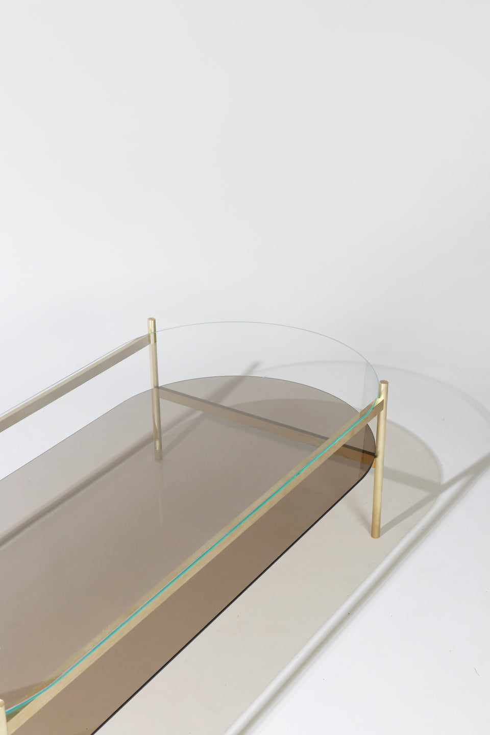 Duotone Pill Coffee Table - Brass Frame / Clear Glass / Bronze Glass