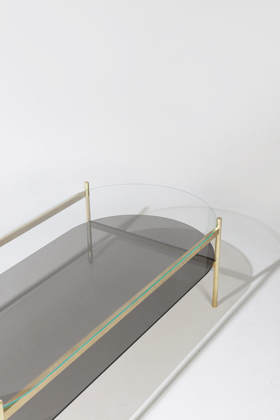 Duotone Pill Coffee Table - Brass Frame / Clear Glass / Smoked Glass