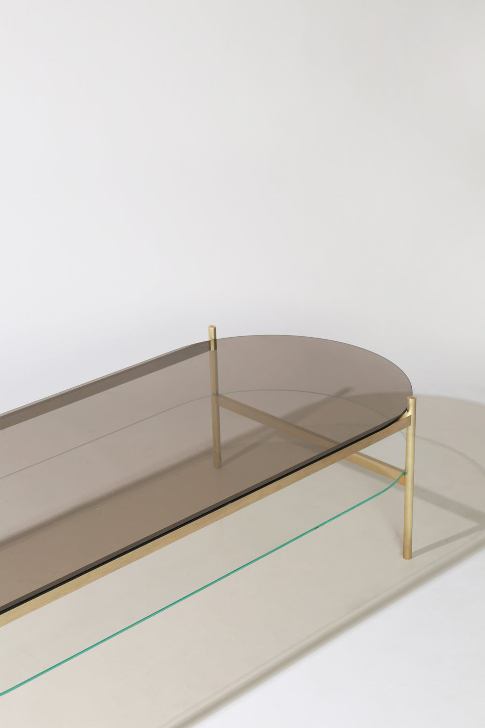 Duotone Pill Coffee Table Brass Frame Bronze Glass Clear Glass Yield