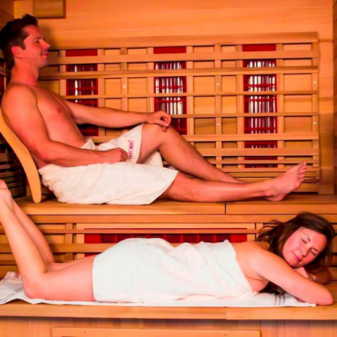 Couple Relaxing in an Infrared Sauna