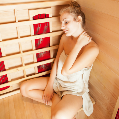Young Blond Woman Relaxing in Infrared Sauna