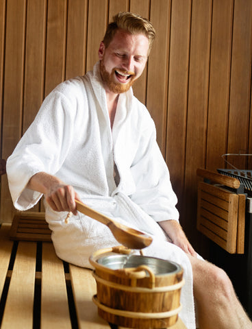 Man Smiling Inside a Sauna