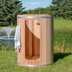 Dundalk red cedar outdoor shower on grass with fountain