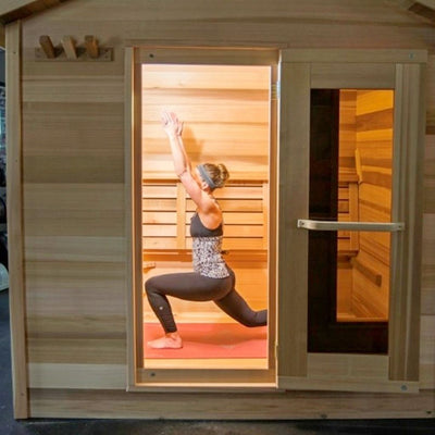 Woman doing yoga exercise in hot yoga sauna