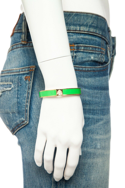 KATE SPADE Hole Punch Spade Bangle - on mannequin