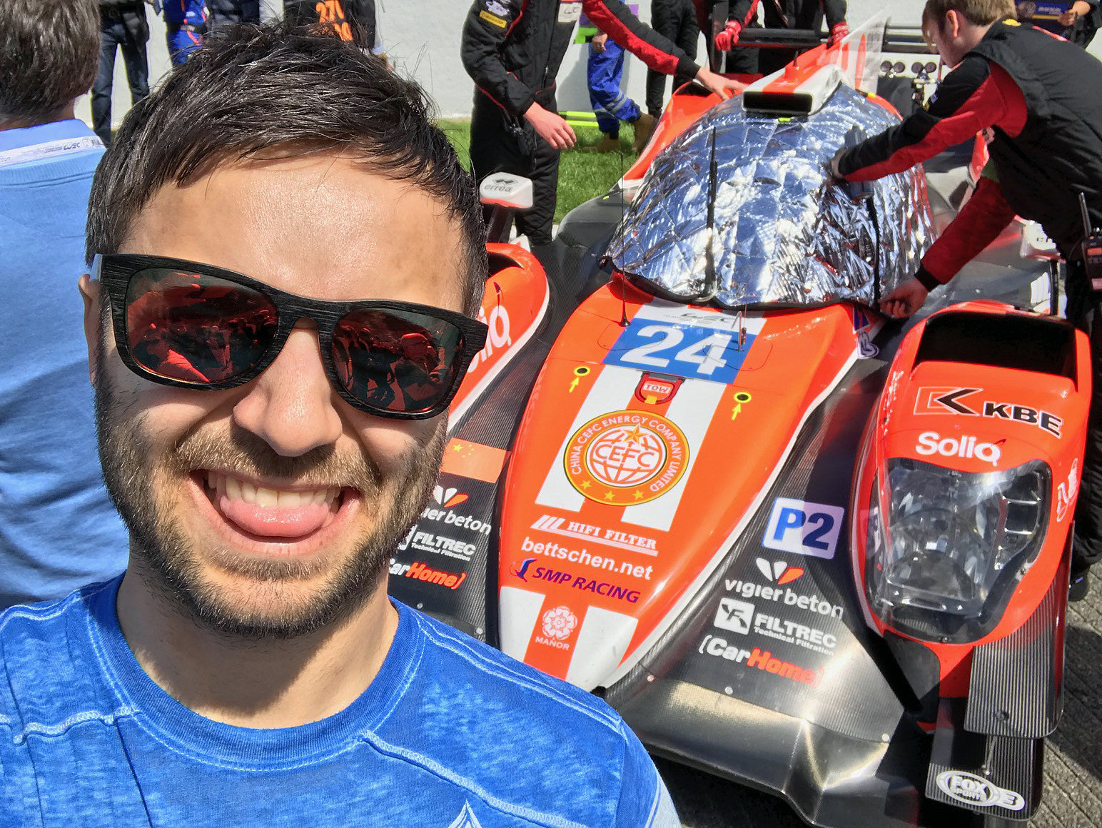 Professional race car driver wearing WearPanda sunglasses