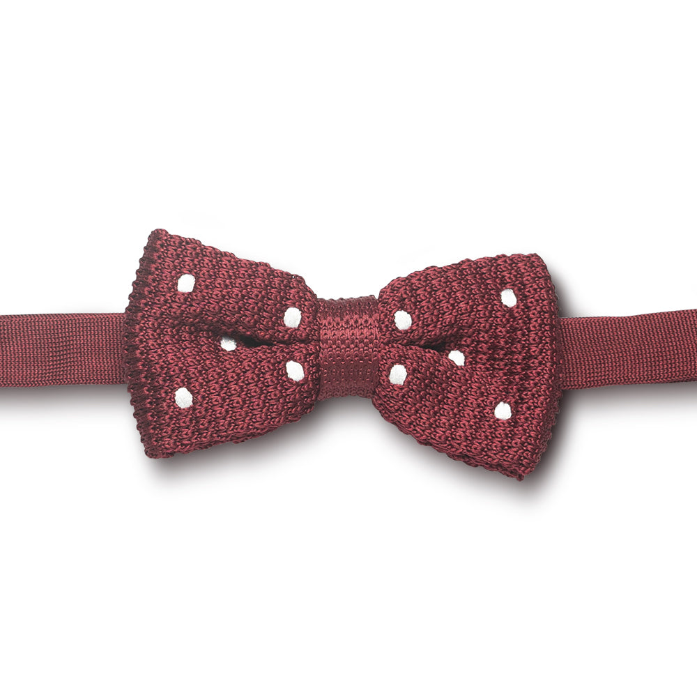 Red knitted bow tie with white polka dots