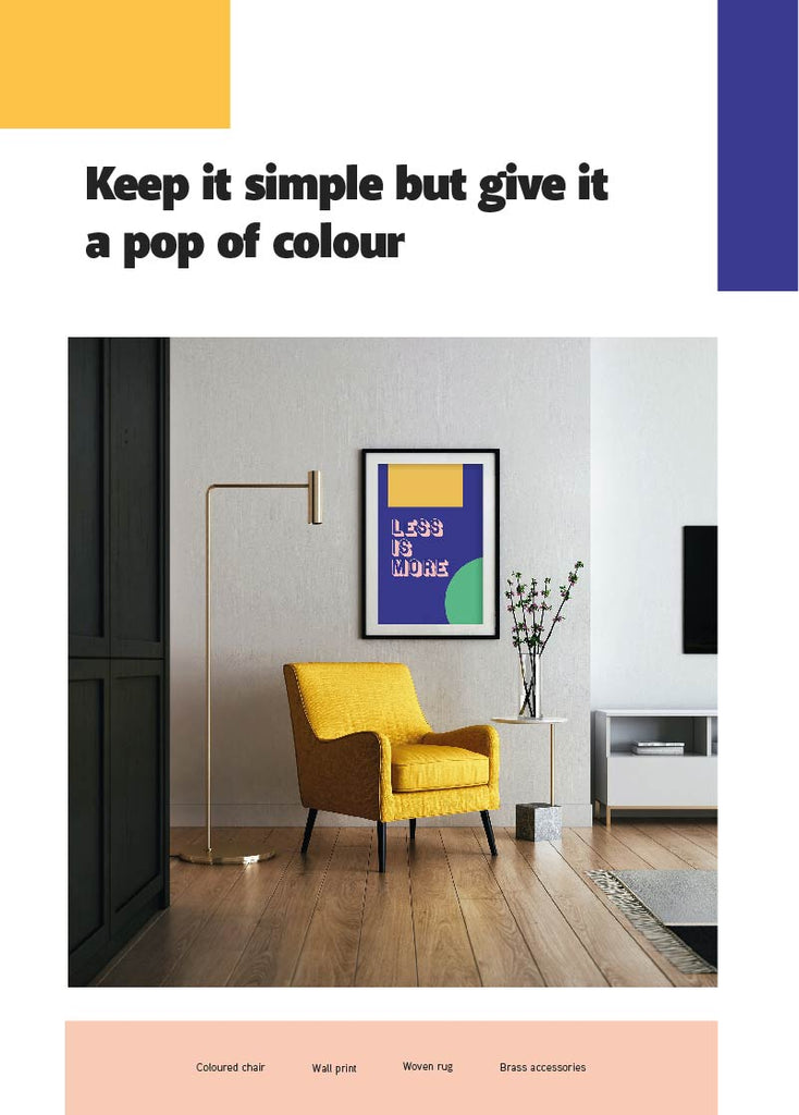 A coloured chair with a wall print on the wall