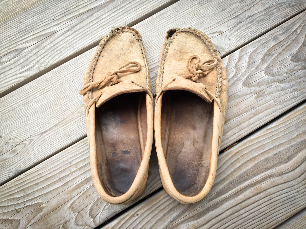 Old worn out moccasins time for a new pair of shoes