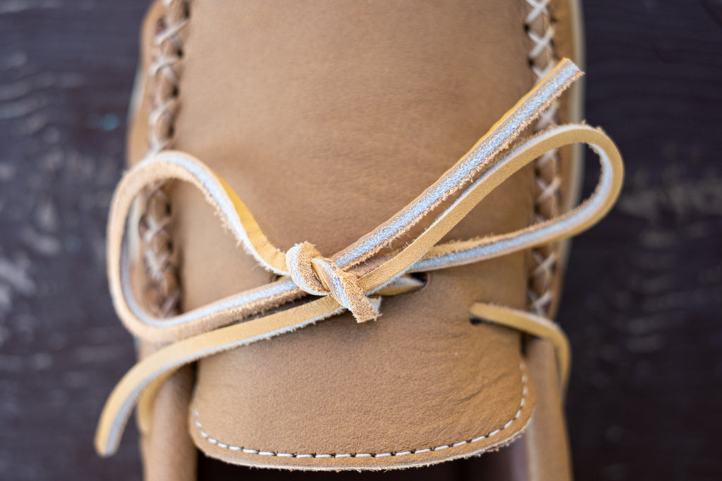 Close-Up of rawhide leather laces on authentic moccasins