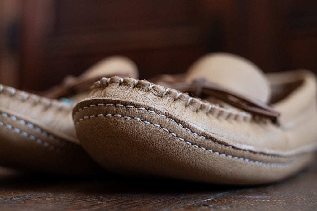Perfected stitching on a pair of moccasins handmade