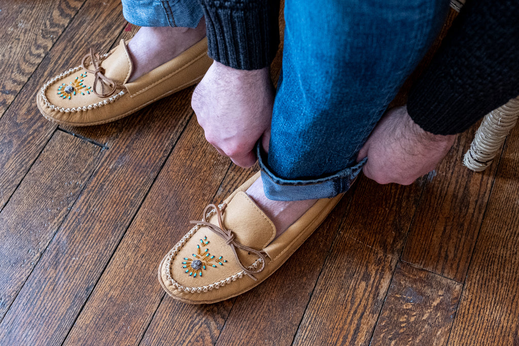 man wearing authentic beaded moccasins