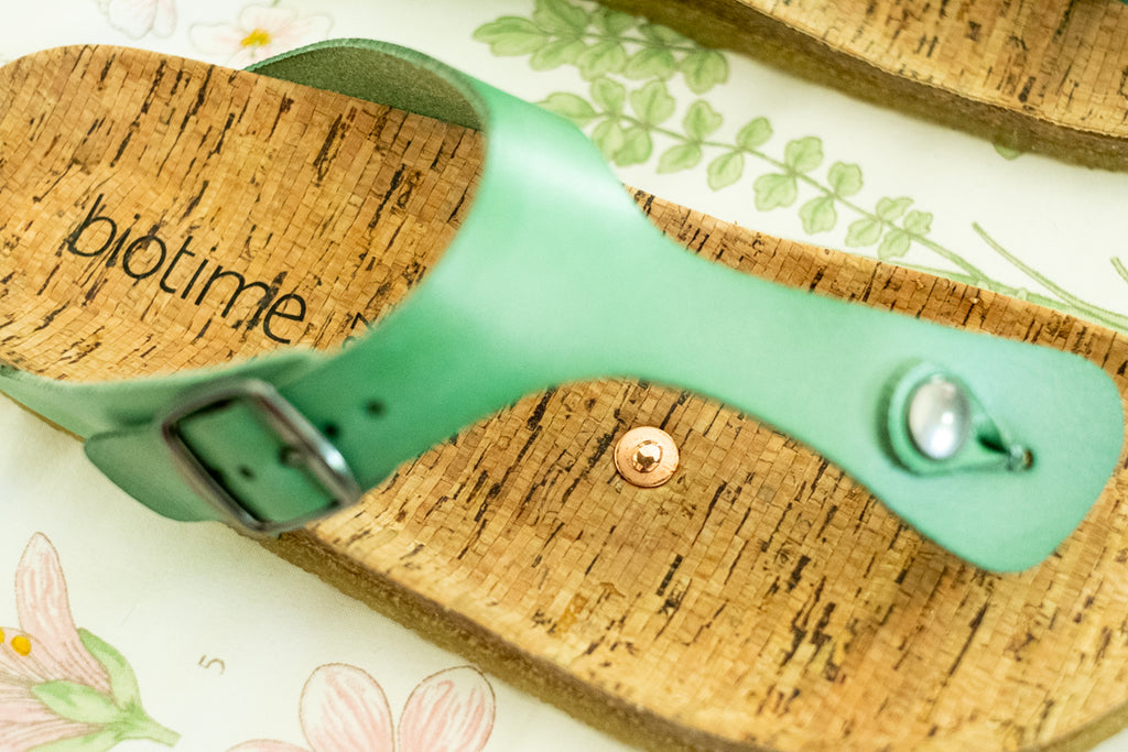 Copper Rivet inserted into soles of earthing sandals by biotime