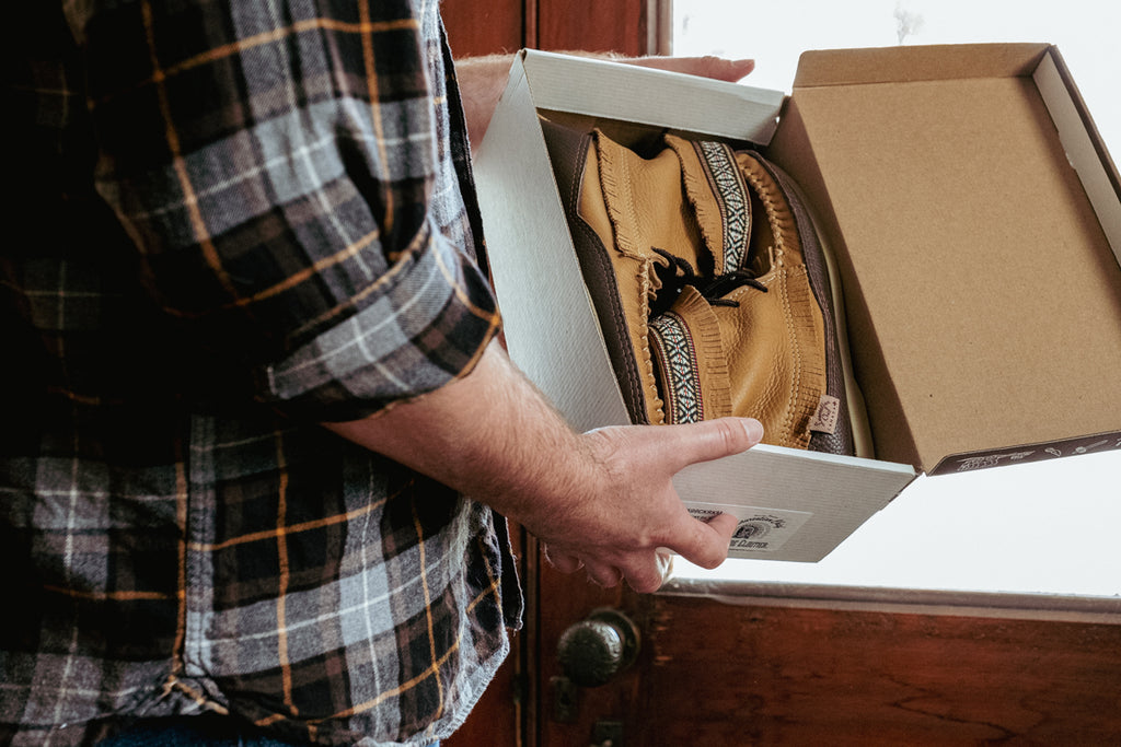 unboxing a pair of Laurentian Chief moccasins made in Canada