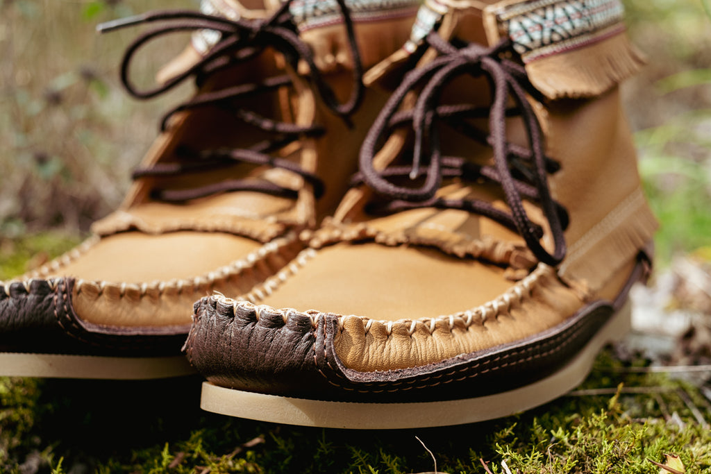 close up of hand-stitching on quality moccasin boots