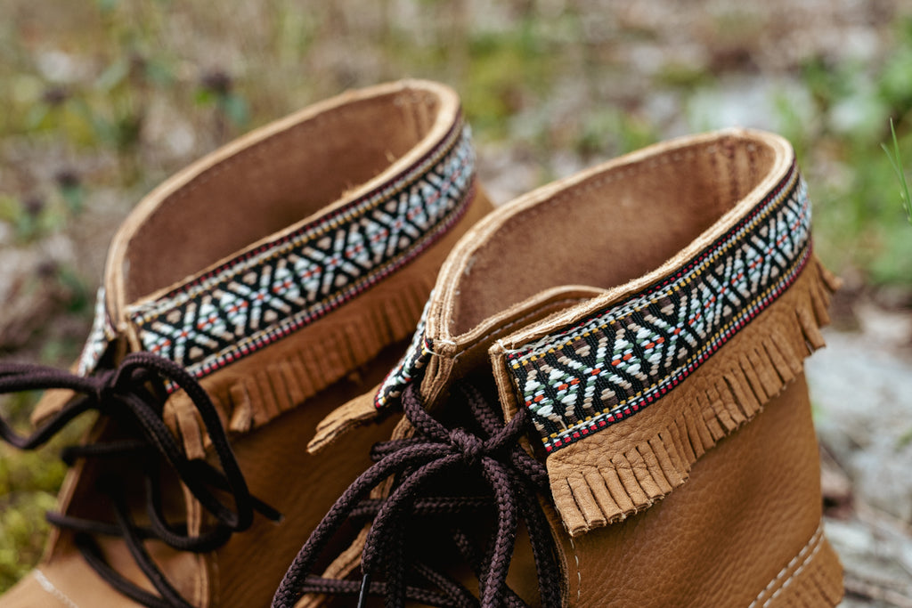 close up of indian braid pattern at the top of moccasin boots