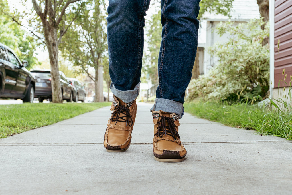 walking in a pair of authentic moccasin boots made from genuine leather