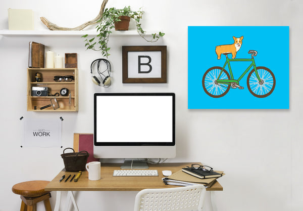 Corgi On A Bike by Joe Van Wetering Wrapped Canvas