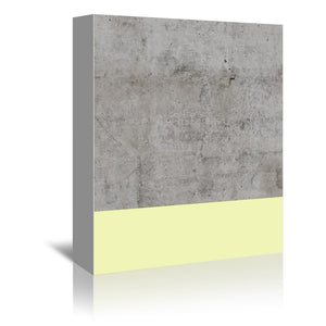 Yellow On Concrete by Emanuela Carratoni Wrapped Canvas