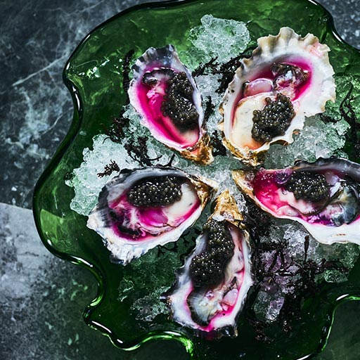 Oysters on the half shell with Ossetra sturgeon caviar