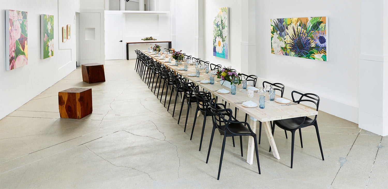 Art Gallery venue setup with 40 person seated table