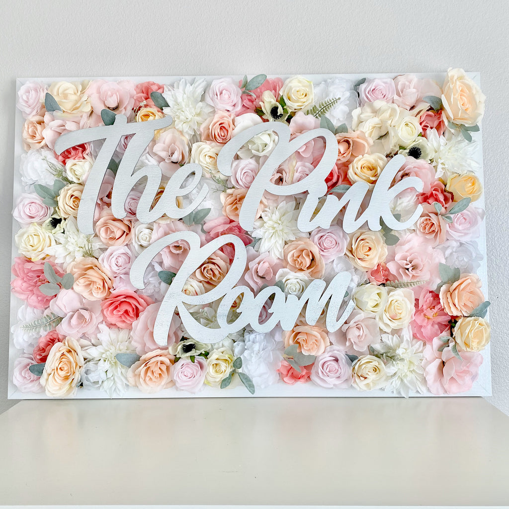 Beautiful framed faux floral wall hanging with wooden name sign is perfect for nursery decor, kids room decor, wedding decor, baby shower decor, or office decor!