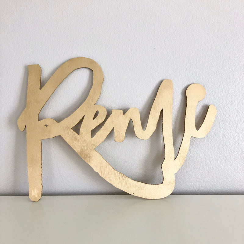 gold name sign wooden sign