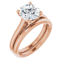 Four Claw Round Brilliant Solitaire Engagement Ring