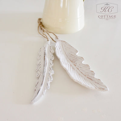 wooden hanging feathers
