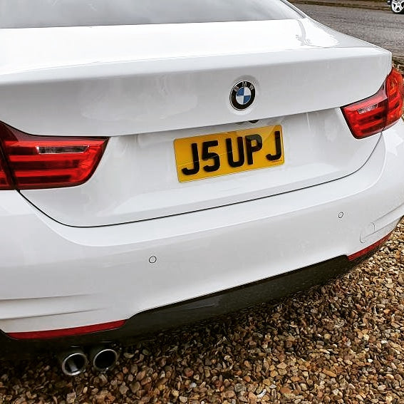 A short 4D plate on this BMW 4 Series