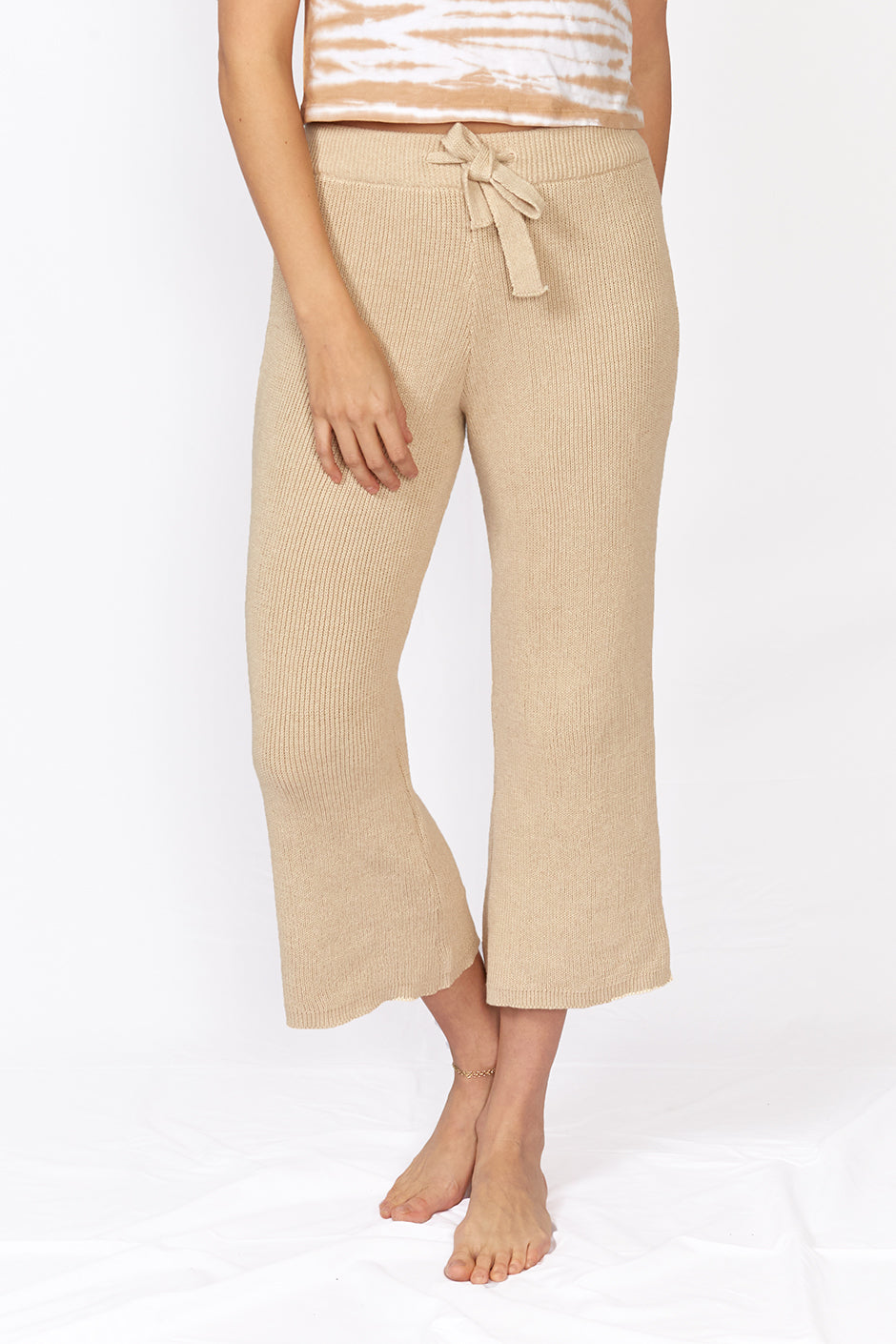 Mirage Pant in Sand color for women by Paneros Clothing. Handmade from sustainable cotton, high waisted and tied with a flare. Front View.