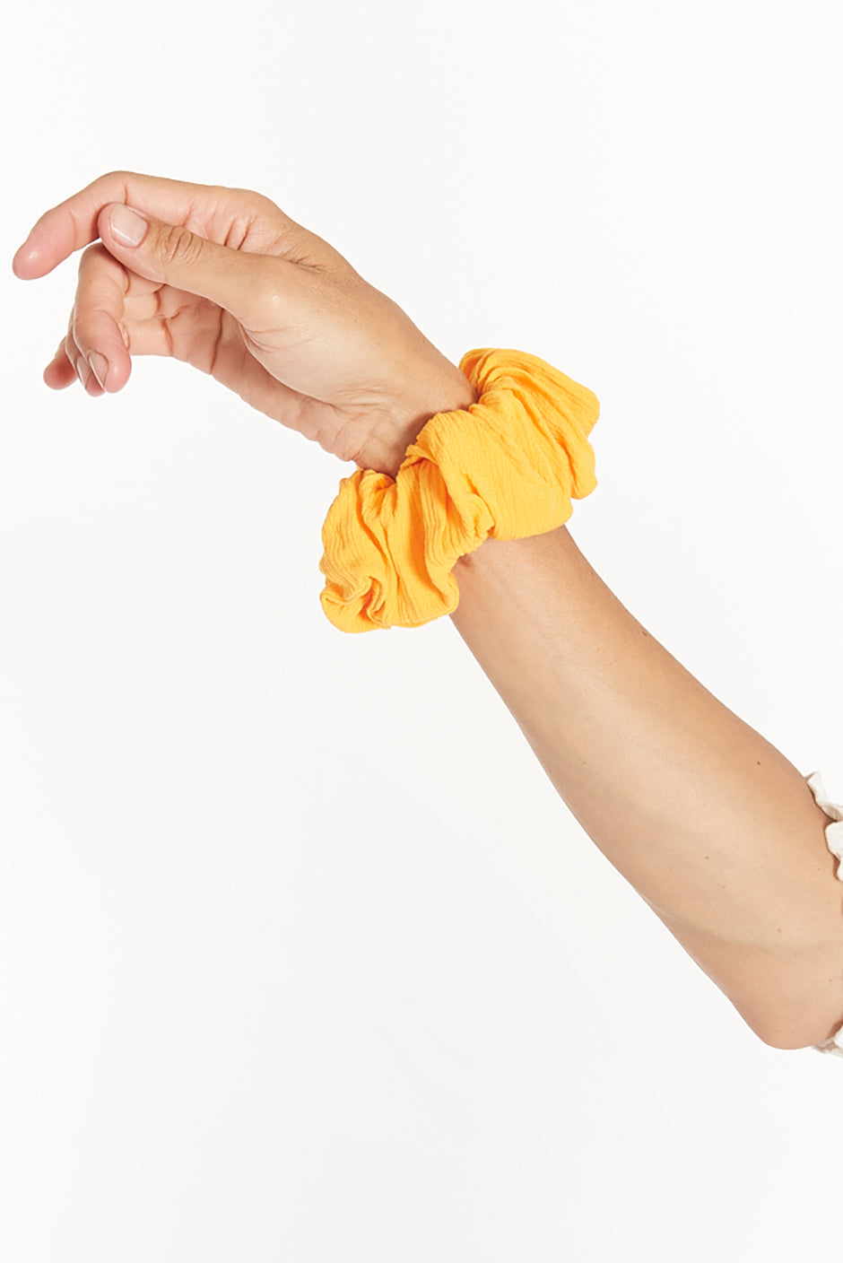 Babe scrunchie for women by Paneros Clothing. Mango colored in 100% Rayon from sustainable leftover fabric.