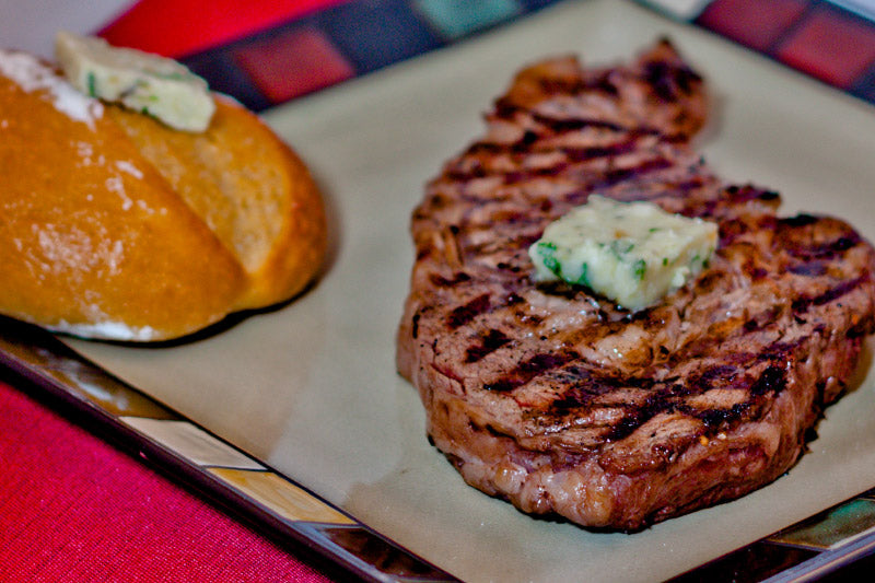 bison ribeye steak with gorgonzola butter and rosemary