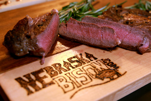 Bison Ribeye Steak on cutting board