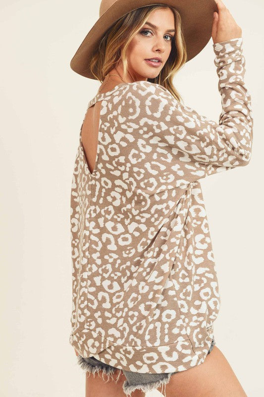 Leopard top with keyhole back, dropped shoulders