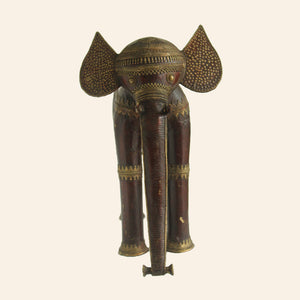 brass metal elephant in wine and gold color. handcrafted in bastar art. front view.