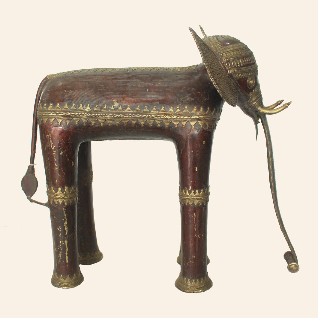 brass metal elephant in wine and gold color. handcrafted in bastar art.