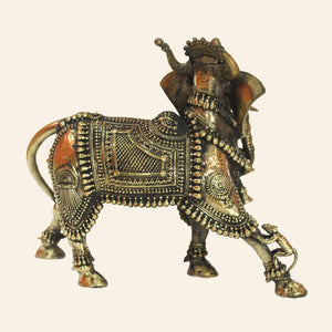 Nandi Bull with Elephant head handcrafted using brass metal in Bastar Art, Dhokra Art. Mythological figure. side view.