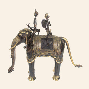 bastar art elephant with two riders, brass metal handicraft. side view.