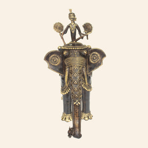 bastar art elephant with two riders, brass metal handicraft. front view.