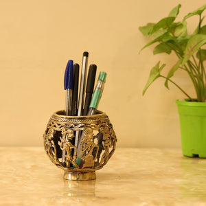 Tribal Figure Brass Pen Holder made in Bastar Art, Dhokra Art, brass color, front view of the pen holder with pens
