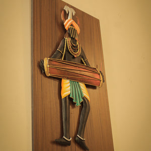 Tribal Man Playing Dholak, made in Wrought Iron and MDF, Bastar Art, color- multicolor, side view