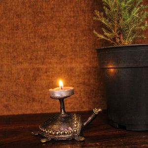 Bell Metal Turtle Candle Holder made in Brass metal in Bastar Art, Dhokra Art, side view with tealight, color - golden brown