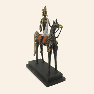Man on horse statue handcrafted using brass metal in bastar art, dhokra art. side view.