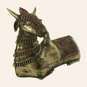 Bull Nandi statue in sitting position. handcrafted in bastar art, dhokra art. front view