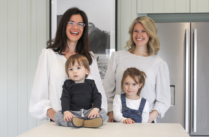 Founders Anita and Georgina with their children